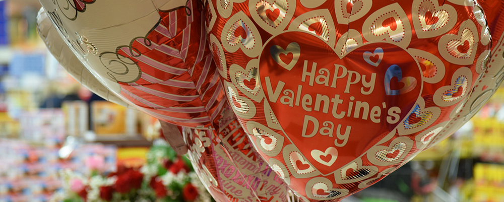 "Large foil balloons that say ""Happy Valentine's Day"""