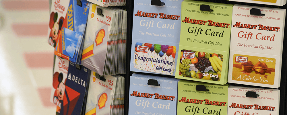A stand of Market Basket gift cards. The Market Basket tiled floor can be seen in the background.